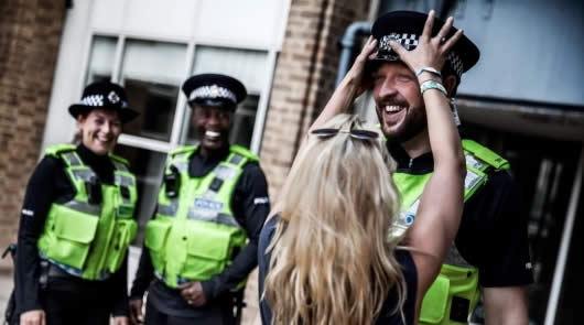 police wearing body cameras smiling